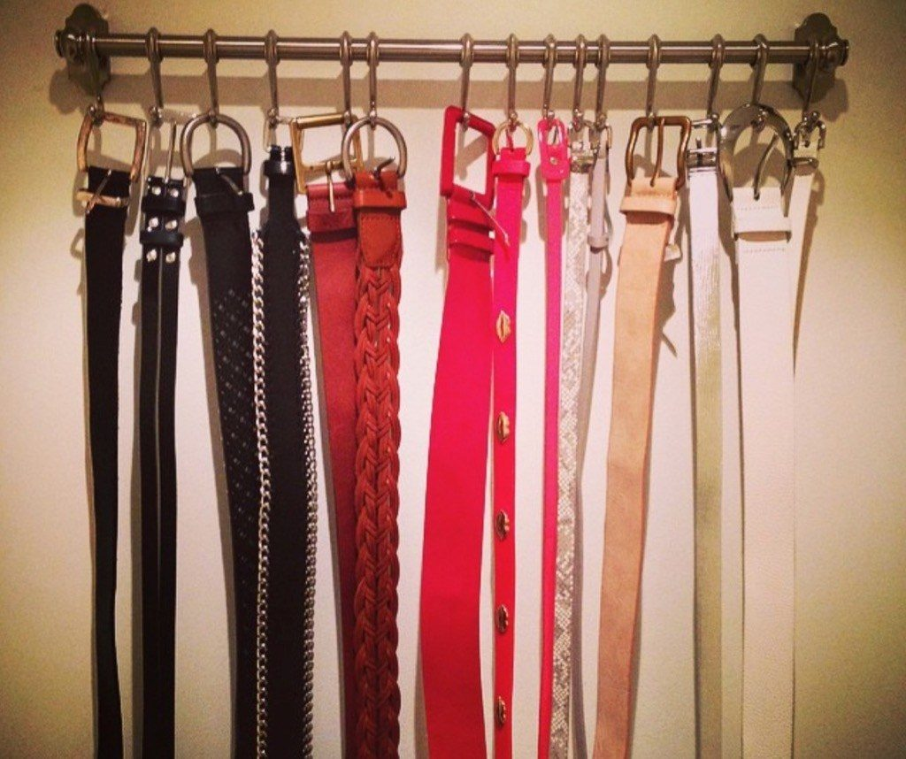 Neatly hang your belts and scarves on towel hangers