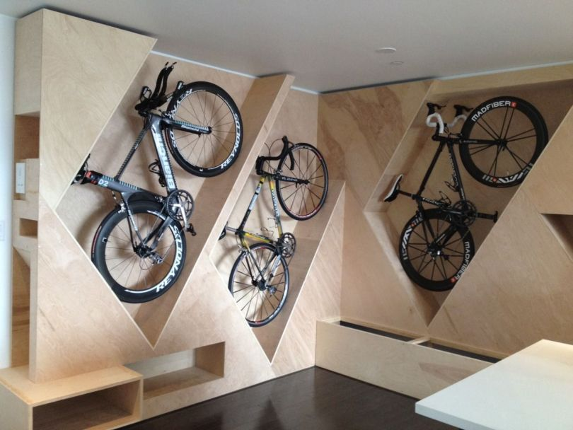 Compartments on a wall for bike storage