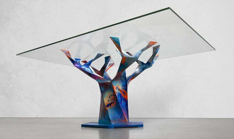 Glass top supported by an art piece