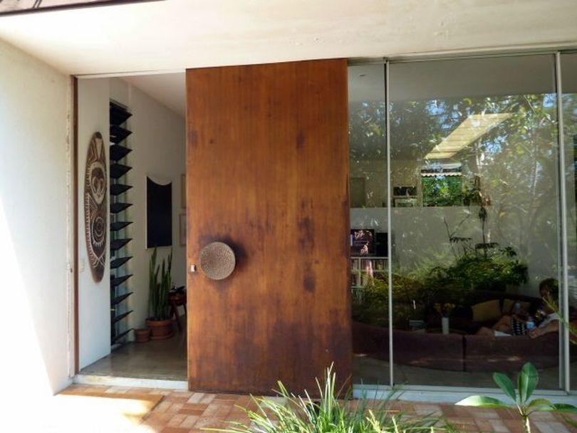 Huge Glass Walls with Sliding Wooden Door
