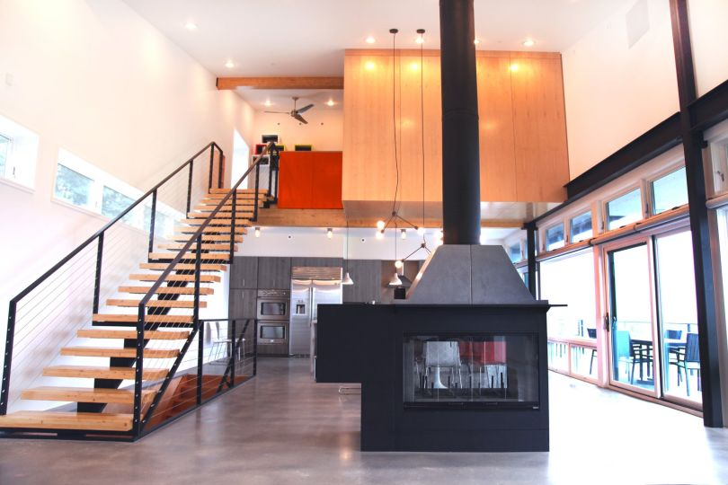Contemporary fireplace on concrete flooring
