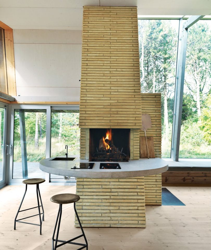 Open plan home with a towering chimney