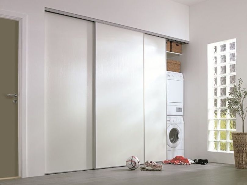 Create utility room behind sliding doors