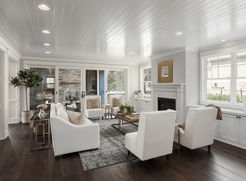 Paint your ceiling white or add a white high-gloss ceiling