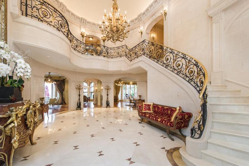 Grand Foyer with Marble Staircase & Ornate Wrought Iron Railings