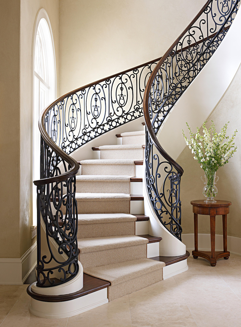 Modern Foyer With Curved Staircase And Iron Railings