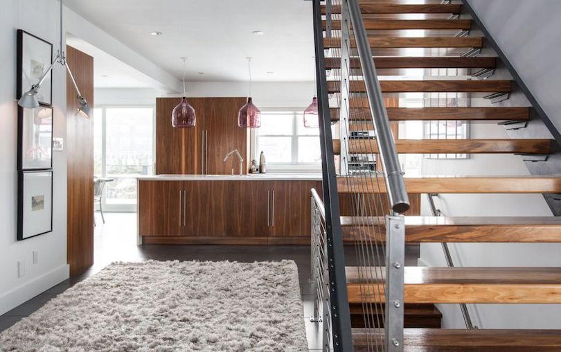 Open Modern Staircase With Black Metal Baluster and Wire Railing