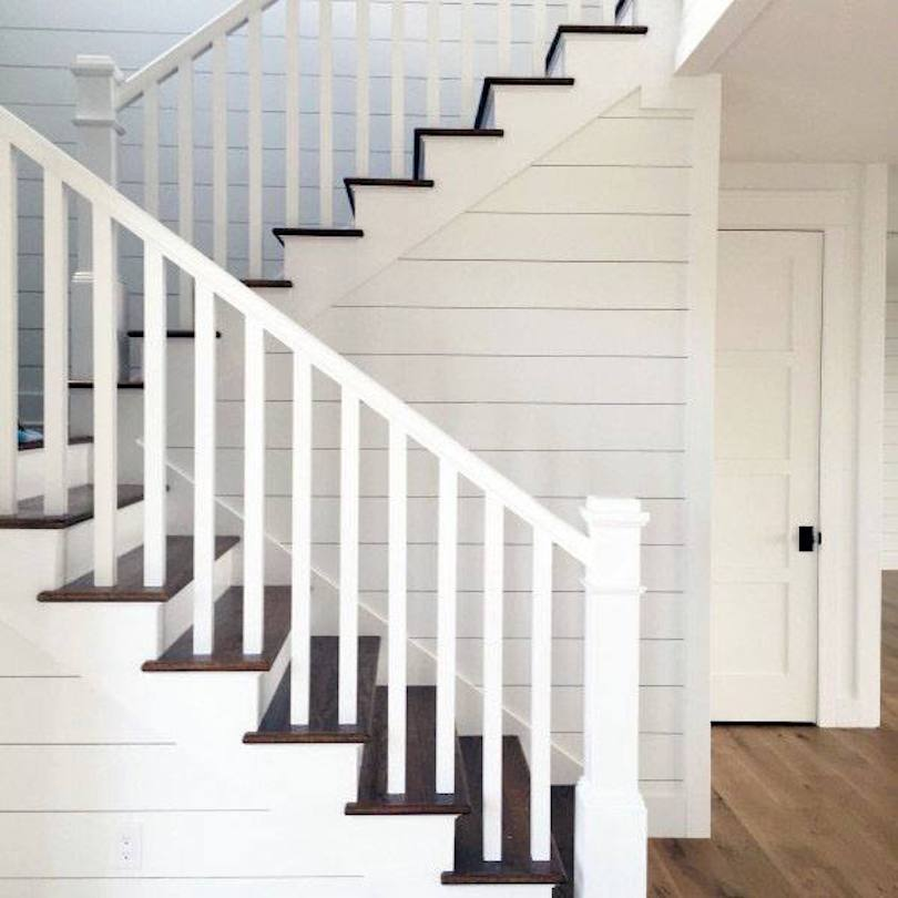 Elegant Staircase with White Steel Railing