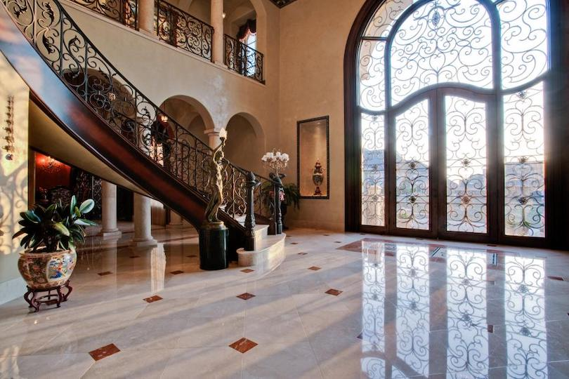 Wrought Iron Railings with Matching Glass Door Panels