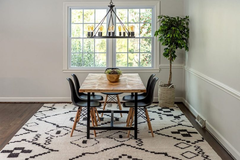 Define the dining room with an area rug