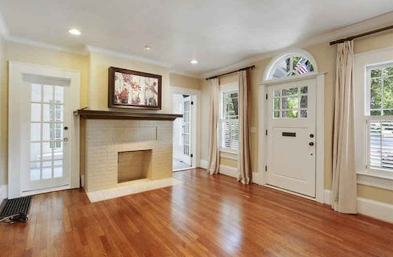 A living room with a double entrance